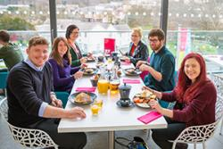 Aled Closs Davies, Gorad Restaurant Manager; Mair Rowlands, Sustainablity Lab; Lydia Richardson,  SU VP Education & Welfare; Ffion Jones, SU; Mark Stanley, SU VP Societies & Communities & Fflur Elin, President, Bangor SU enjoy a Fairtrade breakfast.