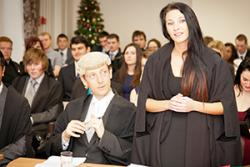 A student takes part in a 'Moot Court'. The mock trial at the Law Fair will be conducted Welsh with simultaneous translation provided.