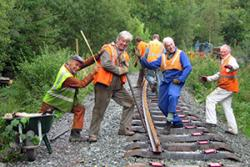 Ffestiniog Railway volunteers enjoying their volunteering experience.