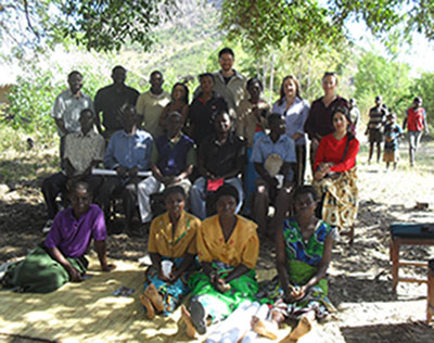 Participants with the farmers during a feedback session.