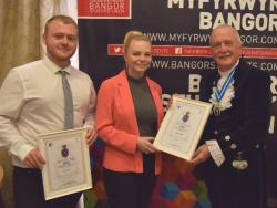 Street Law Directors Tom Crofts and Keira Hand receive their awards from High Sheriff Dr Peter Harlech Jones