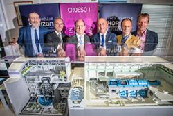 Dr Ian Rees, Grŵp Llandrillo Menai; Francisco Sánchez, Tecnatom; Francisco Javier Guerra, CEO,Tecnatom; Duncan Hawthorne, CE Horizon; Professor Paul Spencer, Greg Evans, Horizon,: behind a scale model of the Advanced Boiling Water Reactor (ABWR)