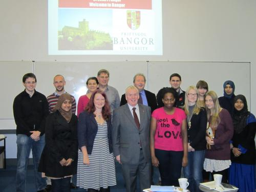 Students from the Big Voice London project with District Judge Owen Williams (front centre) and Bangor's Huw Pritchard, Dr Osian Rees, Gwilym Owen and Aled Griffiths (back row from left).