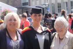 Hannah (centre) with her mother and grandmother.