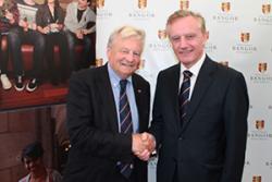 Bangor University Chancellor, Lord Dafydd Elis-Thomas congratulates Professor John G Hughes on his latest Welsh language qualification.