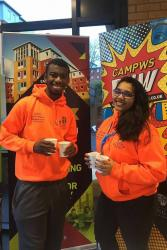 Campus Life Crew members John and Mariya sample some Fair Trade Hot chocolate.