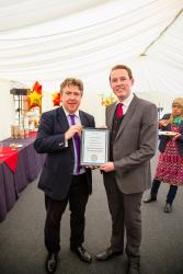 Joshua Nelson is awarded the Oxford University Press Law Prize by Professor Dermot Cahill, Head of Bangor Law School