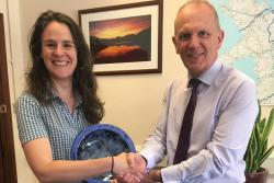 Karin being congratulated by Ifor Gruffydd, Director of Learn Welsh North West at Bangor University.