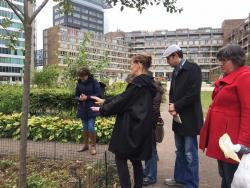 A local resident shows the group and Dr Bartels (second from right) around an urban garden managed by the community to foster an inclusive and sustainable public space