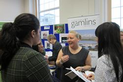 Attendees discuss career options at the Gamlins stand at last year's Law Fair. This year's is expected to be an even larger event.