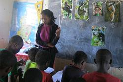 Children in eastern Madagascar learn about lemurs in a school project.