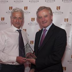 Prof John G Hughes presents the 'Best Improvement in Business Performance and /or Outstanding Innovation' Award to Prof Lew Hardy.
