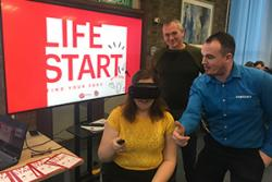 Jenny Light-Hook experiencing VR equipment with Samsung and Virgin representatives.