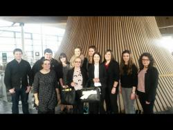 Huw Pritchard (first from left) and Dr Hayley Roberts (first on left, front row) with students at the Senedd, Cardiff Bay