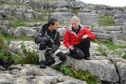 Dr Lynda Yorke explaining to Bear Grylls how the rock beneath them was formed.