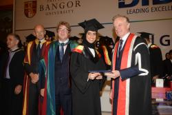 Maryam receives her award from Bangor University Vice Chancellor Professor John Hughes