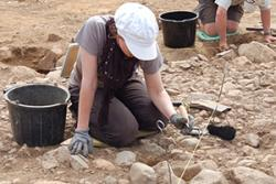 A volunteer on an archaeological dig.