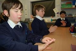 Some of the pupils of ysgol Pen y Bryn, Colwyn Bay practicing Paws B- the version of mindfulness meditation adpated for the classroom are: : left-right: Caeo Adey-Davies, Bryn Hayton and Ali Al- Ranni.