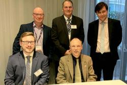 Front: Dr Willy Cook, UNB, & Prof Paul Spencer,Bangor University. Back: Wyn Roberts, head of nuclear supply chains, Welsh Government; Brett Plummer, VP nuclear & chief nuclear officer, NB Power; & Dr Marcus Dahlfors, Sêr Cymru Reader in reactor engineerin