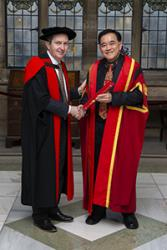 Prof Oliver Turnbull (left) presenting Dr Kuan with his Teaching Fellowship.