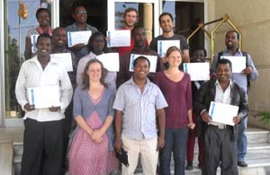 The participants with their certificates