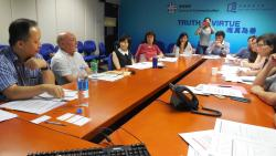 Peter Huxley, second from left, presents his research findings to representatives from Hong Kong NGOs