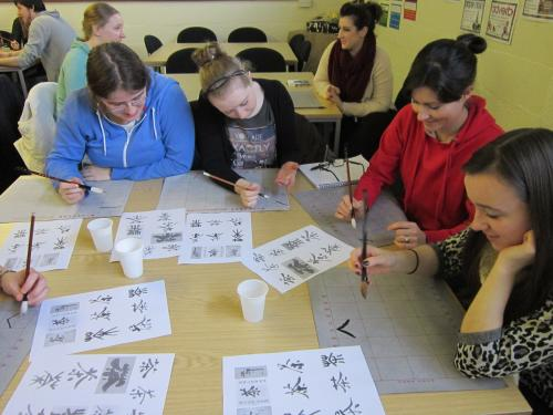 Students try out Chinese calligraphy during the cultural workshop