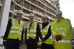 John Griffiths AM on site with Professor John G Hughes, Vice-Chancellor, Elen ap Robert, Pontio's Artistic Director and Dylan Roberts, Director of Estates at Bangor University