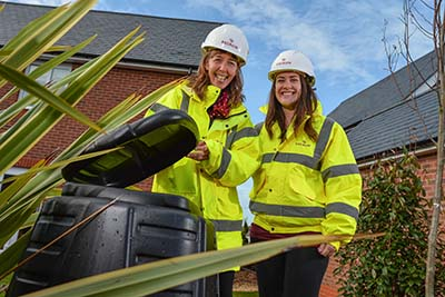 Guest lecturer Nicola Owen with Redrow sustainability assistant Anna Hughes at the Goetre Uchaf development.