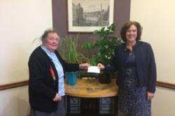 Rev Wendy Williams, Dr Williams' sister and fellow Bangor alumnus, presents Prof Morag MacDonald, Head of the School of Environment, Natural Resources and Geography (right), with her brother's bequest.