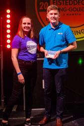 Alistair Mahoney received the Musicians' Trophy from Becca Martin.