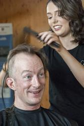 Ronan Roche of the School of Ocean Sciences mid head-shave.