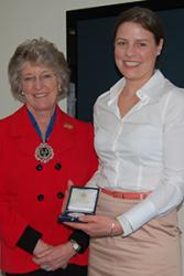 Rosie Poynor receives her Drapers' medal from Master Draper: Lady Victoria Diana Leatham, DL