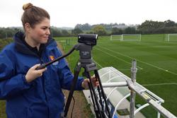 Student volunteer Abbey Forshaw filming at the sports analysis training session.