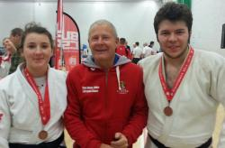 Samantha Hemming (left) with her coach, Steve Clarke and team mate Farzad Abdollahzadeh