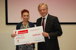 Undergraduate winner Catrin Hicks from the School of Education received her prize from the Vice-chancellor, Professor John G. Hughes.