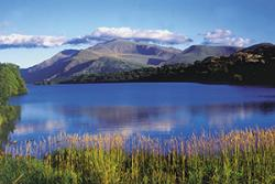 An iconic view of Snowdon, with Llyn Padarn in the foreground.