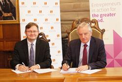 Andrew Bacon, Chief Executive of Enactus UK and Professor John G Hughes, Bangor University Vice-Chancellor sign the agreement.