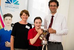 Sian Stoodley (European Commission) and Talat Chaudhri (Aberystwyth Council Deputy Mayor) handing the trophy for the German category to locfat language student, Efa Huw, of Ysgol Tryfan.