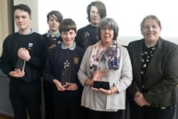 From left:  Tomos Laing year 10, Oscar Downing year 9, Gwyn Owens year 10 and Owen Hughes year 11 with their Chemistry Teacher Mrs David and Dr Lorrie Murphy