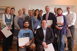 Bangor University staff and postgraduates with their certificates.