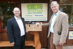 Green Innovation Network Project Manager, Stuart Bond (left), presents Stephen Bristow, Managing Director of Greenwood Forest Park with the Welsh produce hamper.