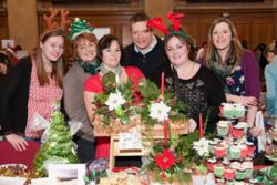 Judges; John Jackson and Mari Roberts (right) with winning stall holders, Tinsel a Sbeis.
