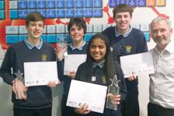 Dr Mike Beckett, Head of Chemistry at Bangor University with the winning team from St Gerard's School: (left-right) Andreas Alexandrou. Matthew Willis, Shenona Mitta, Jacob Alexandrou.