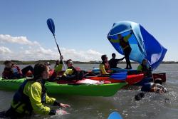 A group experiences sea kayaking and sea kayak sailing.: Image credit: Trys Burke