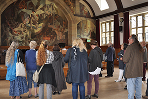 A previous tour view Ed Povey's Hall of Illusions mural in the University's Neuadd Powis.