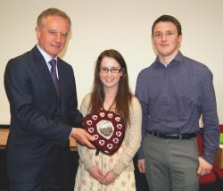 The Vice Chancellor presenting Victoria and Joe with the Peer Guide of the Year shield.