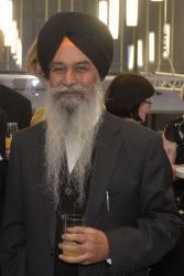 Dr Daljit Singh Virk yn ystod derbyniad yn 2015.