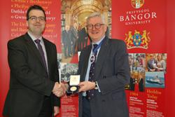 Stephen Clear (left) being awarded the Silver Drapers' medal from Master Draper, Nicholas Bence-Trower