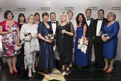 Members of the WHELF Shared LMS team with their award. Flora Lewis (far Right) represented Bangor University at the event.: Image courtesy Times Higher Education